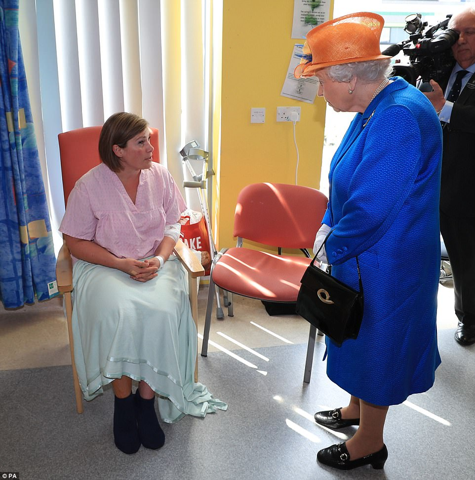 Mother Ruth Murrell, who is recovering after being struck by shrapnel, told the monarch her daughter Emily was undergoing surgery for her injuries. The mother said seeing the children coping with their injuries was 'inspiring'