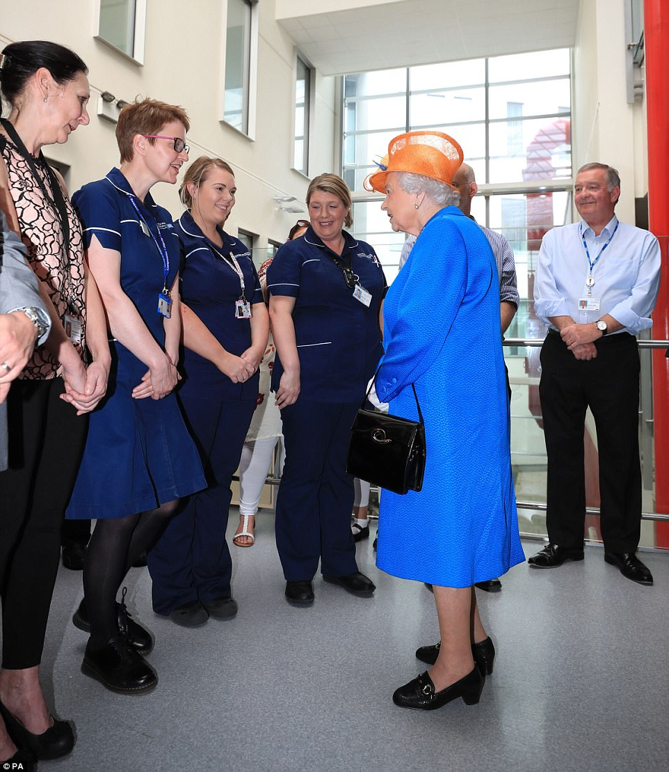 Gratitude: Hospital workers looked delighted to be meeting the Queen this morning