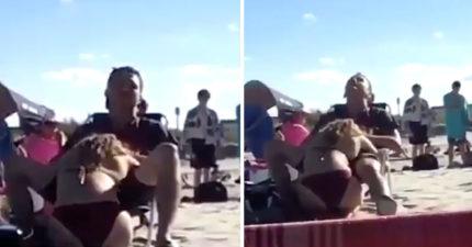 沙灘上公然讓女友「吃腿中熱狗」,「一直點頭」一旁小孩拍下研究。(影片)