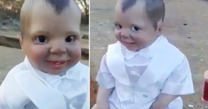 「男童」一直盯著鏡頭詭異微笑,眾人走近才發現「超毛真面目」:是惡魔...(影片慎入)
