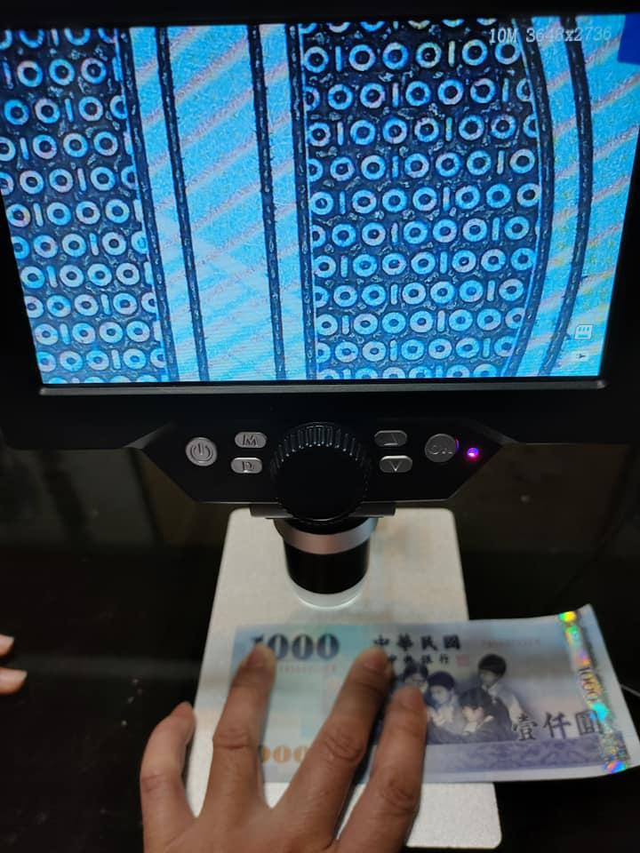 放大千元鈔...漸層線條下現「神祕玄機」 網友笑:找到國家寶藏了嗎?